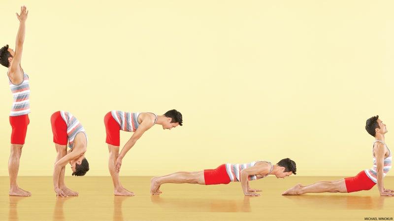 yoga man doing vinyasa sun salutation