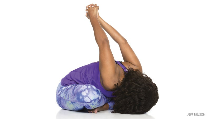 """From Warrior Pose II, flip your front palm up toward the sky. On an inhalation, reach that arm up and toward the back of your mat, creating maximum length through your left side body as your right hand slides down your back leg. As you do this, try to keep a deep bend in your front (left) knee. Stay here for 1 full breath, silently repeating: """"I am strong."""" Repeat poses 2–7 on the other side, then come into Downward-Facing Dog.See also Baptiste Yoga: A Twisting Advanced Core Flow"""