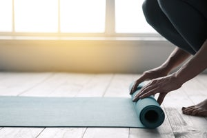 Yoga for Back Health: How to Protect Your Spine While Picking Up (& Putting Down) Props