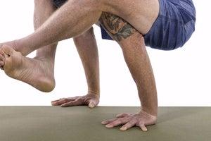Shoulder-Pressing Pose (Bhujapidasana)