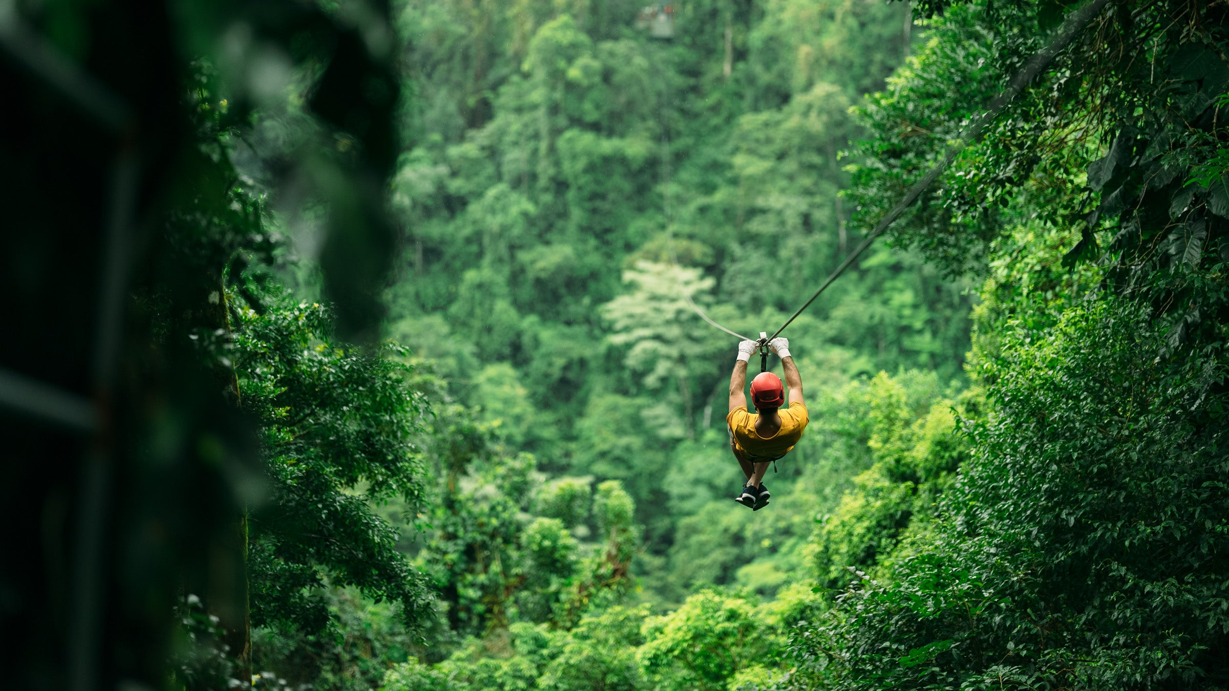 Person zip-lining in Costa Rica