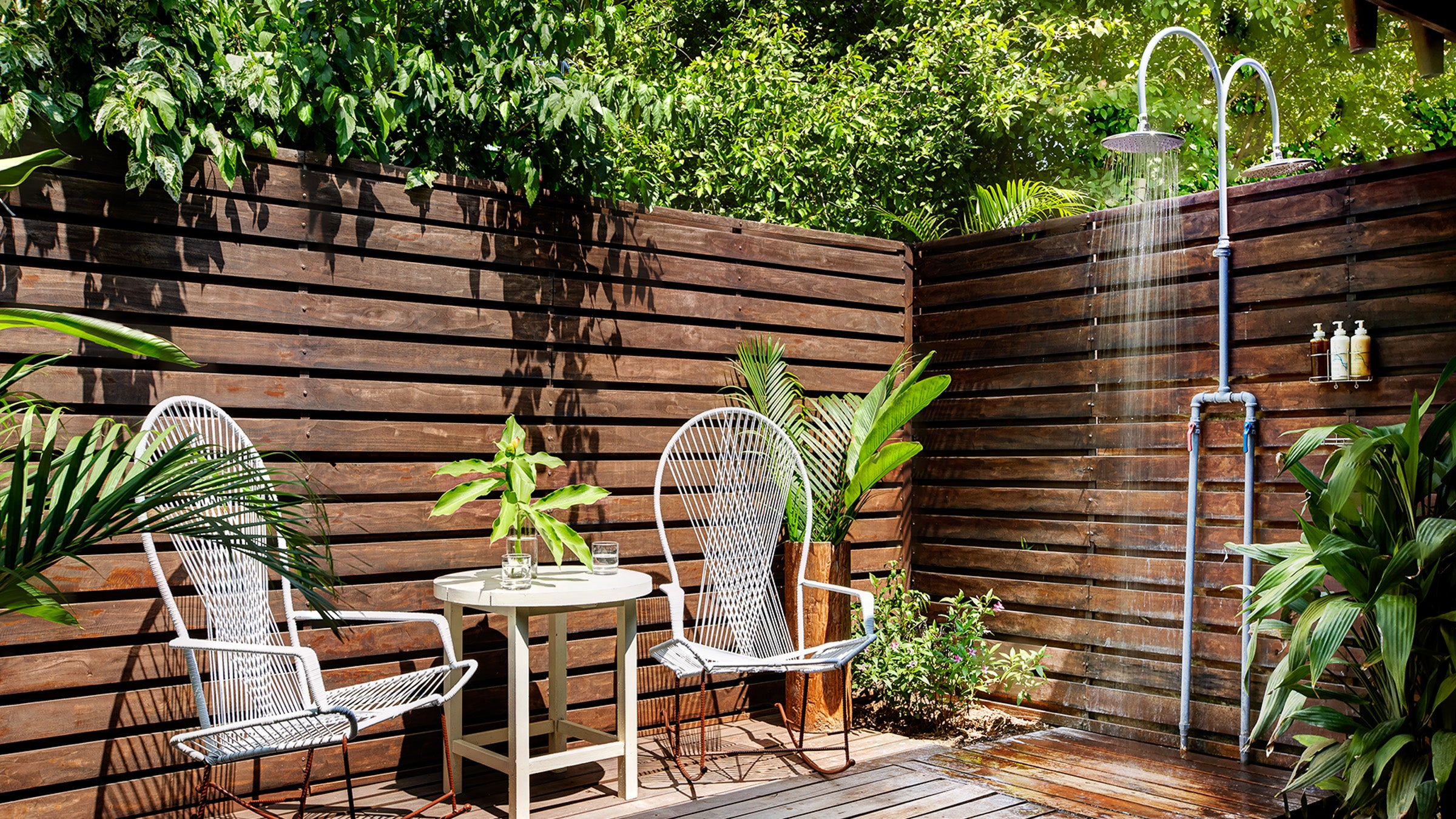 Outdoor shower with two chairs