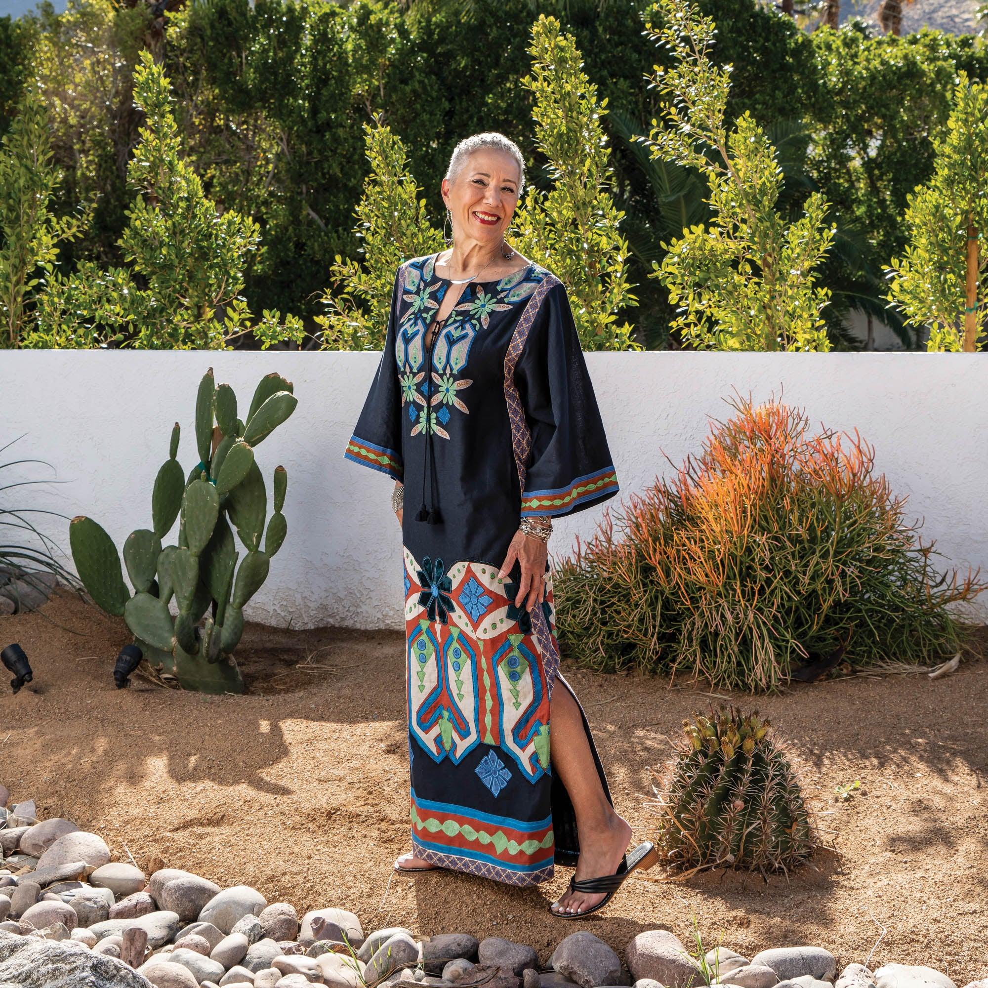 Gail Parker outside in a long dress