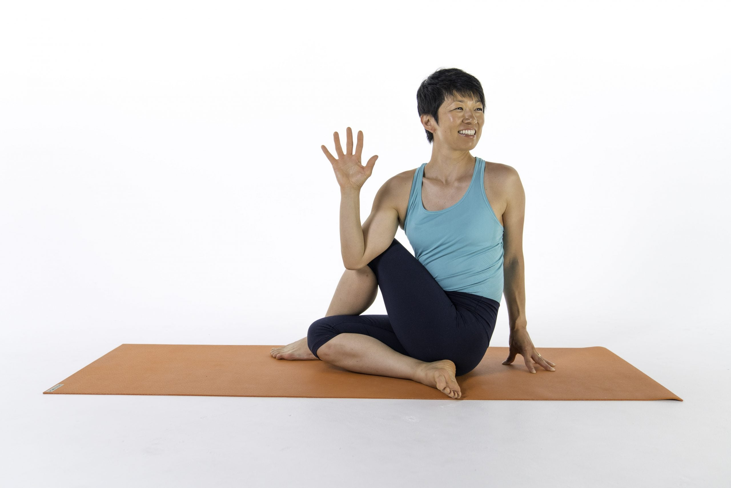 Asian woman in blue dong Half Lord of the Fishes (Ardha Matsyendrasana)